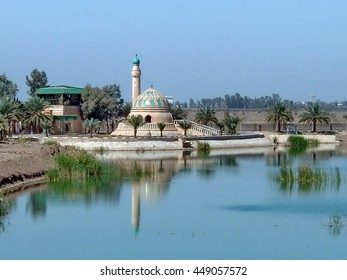 BAGHDAD, IRAQ - CIRCA 2005: Small mosque on the banks of an artificial lake on a former Baath Party compound