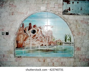 "BAGHDAD, IRAQ - CIRCA 2005: Tile mosaics inside the ""Flinstone Palace"" a lakeside pleasure house built by Sadaam Hussein which was enclosed in a Forward Operating Base"