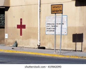 BAGHDAD, IRAQ - CIRCA AUGUST 2007: Red cross painted on a existing building on a Forward Operating Base to form a first aid post