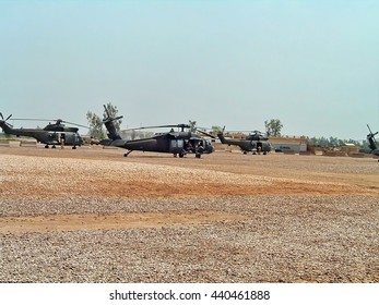 BAGHDAD, IRAQ - CIRCA MAY 2005: Choppers on a dirt landing zone on Camp Victory