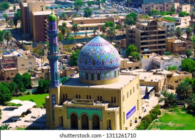 Baghdad, Iraq – December 31, 2014: A picture of Fardous Mosque Or as it is called 17 Ramadan Mosque during the night, Contains one dome and one minaret,