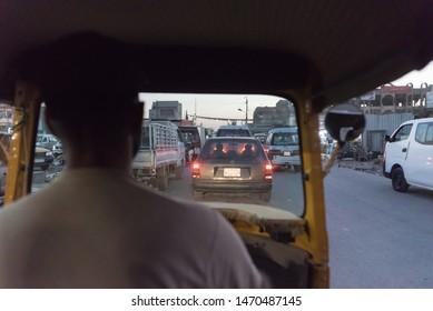 Baghdad, Iraq – Jun 29, 2019: Tuc tuc driver back view