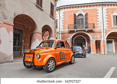 """BAGNACAVALLO, RA, ITALY - NOVEMBER 10: unidentified driver on a tuned vintage car Fiat 500 during the rally """"Meeting Fiat 500 e auto d'epoca"""" on November 10, 2013 in Bagnacavallo, RA, Italy"""