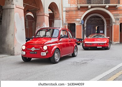 "BAGNACAVALLO, RA, ITALY - NOVEMBER 10: unidentified driver on a red vintage car Fiat 500 runs during the rally ""Meeting Fiat 500 e auto d'epoca"" on November 10, 2013 in Bagnacavallo, RA, Italy"