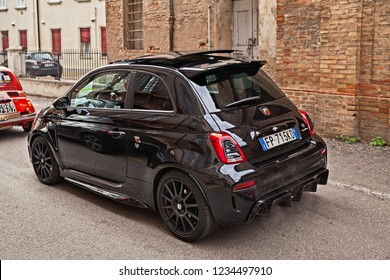 Bagnacavallo, RA, Italy - November 11, 2018: Italian sports car Abarth 595 Competizione, a performance model of the Fiat 500, traveling during the 24th Meeting auto vintage