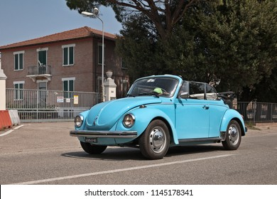 "Bagnara di Romagna, RA, Italy - July 29, 2018: crew on a vintage Volkswagen Type 1 (Beetle) convertible in Classic car rally ""33st Raduno moto e auto d'epoca"""