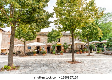Bagno Vignoni, Italy - August 26, 2018: Medieval town by San Quirico d'Orcia in Val d'Orcia, Tuscany with empty street historical buildings and restaurant