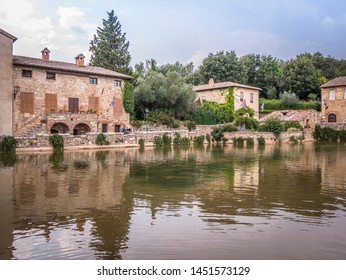 """Bagno Vignoni / Italy / Tuscany - 08/19/2018 - """"Piazza delle sorgenti"""" - source of hot thermal water, inside the Val d'Orcia Natural Art Park."""