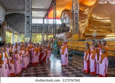 Bago. Myanmar. 01.22.13. Group of novice nuns at the Shwethalyaung Reclining Buddha in Bago in Myanmar (Burma).