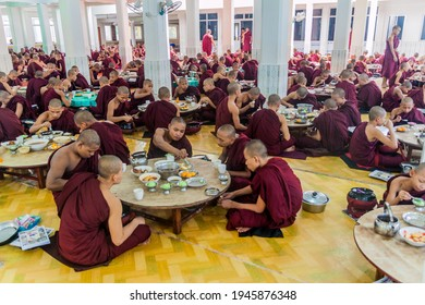 BAGO, MYANMAR - DECEMBER 10, 2016: Monks of Kya Kha Wain Kyaung temple in Bago eat their lunch.