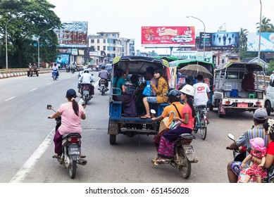 BAGO, MYANMAR - SEPTEMBER 19, 2015 : Street traffic in Bago or Hanthawaddy, Myanmar on September 19, 2015. Bago is the city and large city located 57 miles (90 km) north-east of Yangon ,  Myanmar