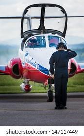 BAGOTVILLE, QUEBEC/CANADA  - JUNE 22: Bagotville Airshow. A Canadian Snowbirds pilote and a mecanician doing their salute in Bagotville, Quebec, Canada on June 22, 2013.