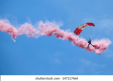 BAGOTVILLE, QUEBEC/CANADA  - JUNE 22: Bagotville Airshow. The Canadian Forces Skyhawks Parachute Team doing figures with smoke. in Bagotville, Quebec, Canada on June 22, 2013.