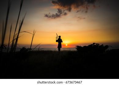 Bagpiper at Sunset