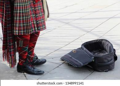 Bagpipes Player Busking In Edinburgh