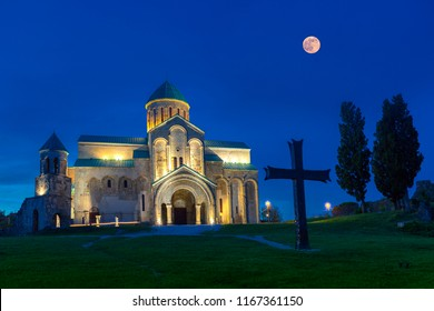 Bagrati Cathedral at the twilight with full moon risingin Kutaisi, Georgia