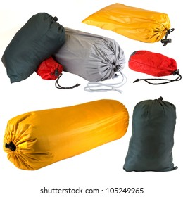 Bags of camping equipment isolated on a white background.