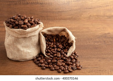 Bags of coffee bean on wooden background