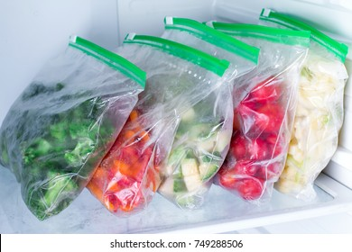 Bags with frozen vegetables in refrigerator