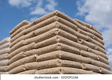 Bags ful with wooden biomass formed in pellets