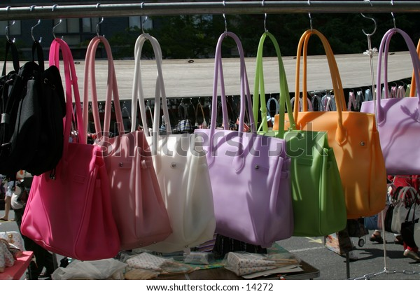 bags hanging at outdoor market