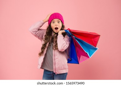 Bags perfect for carrying all epic shopping. Shocked shopper hold shopping bags. Little child with paper bags. Small girl carry holiday purchases in colorful bags. Autumn sale and discount.