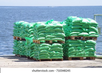 Bags of rice on pallets ready to be shipped by sea to support the humanitarian aid.