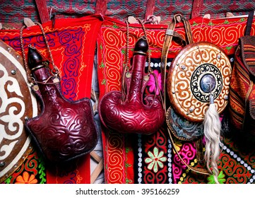 Bags from skin for water and shield on the wall of Kazakh yurt at Nauryz celebration in Almaty, Kazakhstan