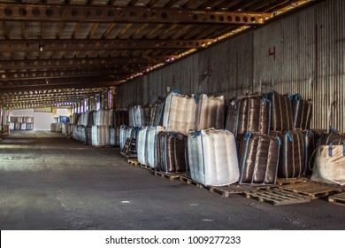 Bags in the warehouse. Bales on pallets in stock.