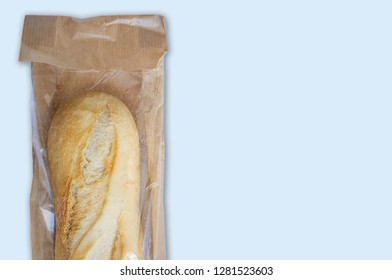 Baguette bread in plastic lined paper bag with clear window. Isolated over white
