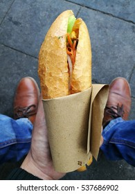 Baguette bread with vegetable and meat filling (called Banh My or Banh Mi in Vietnamese) - popular street food in Vietnam.