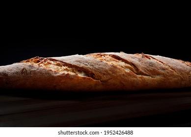 Baguette close-up. Baguette side view. Art bread.