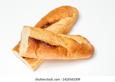 Baguette cut in half, Baguette bread, French bread, Organic baguette francese on white background