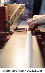 Baguette cutting machine, master cuts baguette, in Framing Workshop