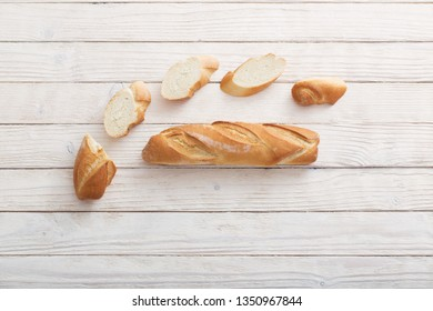 baguette on white wooden background