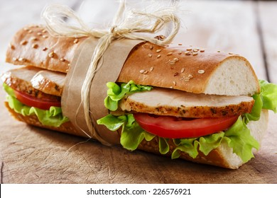 baguette sandwich with grilled chicken and tomatoes