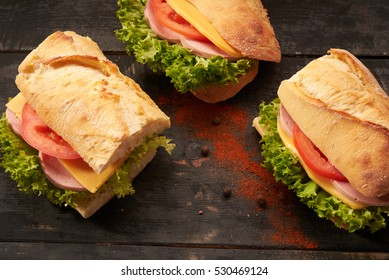 baguette Sandwiches on the wooden table