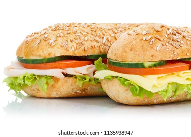 Baguette sub sandwiches ham and cheese closeup isolated on a white background