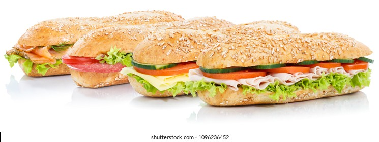 Baguette sub sandwiches with salami ham cheese salmon fish whole grains fresh isolated on a white background
