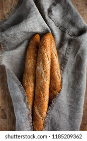 Baguette wrapped in sackcloth