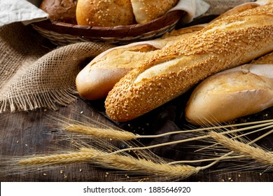 Baguettes on a brown wooden table. French bread close-up