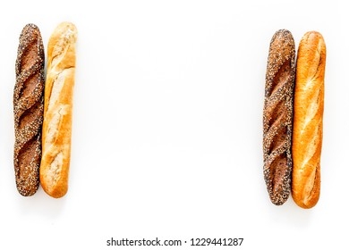 Baguettes. White and brown on white background top view