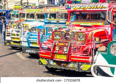 BAGUIO, PHILIPPINES - FEBRUARY 4, 2014: colorful jeepneys at the bus station of the city of Baguio. Inspired from US military jeeps, those are the cheapest and kitschest transportation in the country.