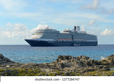 BAHAMAS - DEC 27, 2014: Holland American Line Cruise ship Nieuw Amsterdam anchore offshore in Half Moon Cay (Little San Salvador Island), Bahamas.