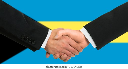 The Bahamas flag and business handshake