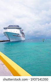 BAHAMAS ISLANDS - JULY 12, 2017: The Carnival Pride cruise ship is moored off the coast of the Bahamas island near the pier