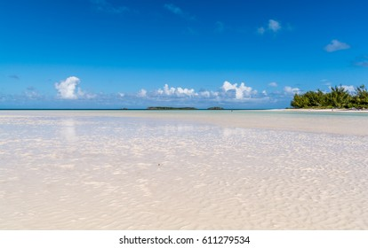 Bahamian pink sand beach showing coastal line at low tide