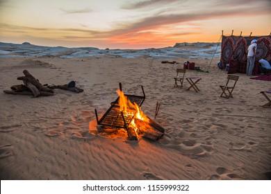 BAHARIYA, EGYPT - June 2018: Camping in the desert. White desert in Egypt. Tents and fire in the Sahara desert, Egypt