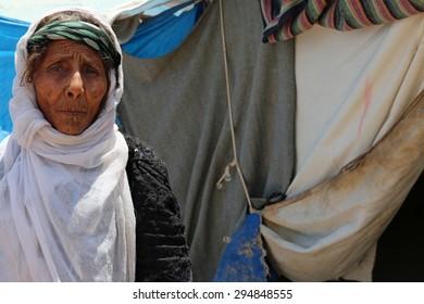 BAHARKA REFUGEE CAMP, ERBIL, KURDISTAN, IRAQ - 2015 JULY 1  - A elderly grandmother inside Baharka refugee camp.
