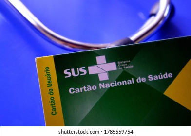 Bahia, Brazil - April 28, 2020. Translation: Brazilian Unified National Health System (SUS - Sistema Único de Saúde, in Portuguese). / SUS card (Cartão do SUS) and stethoscope in the background.